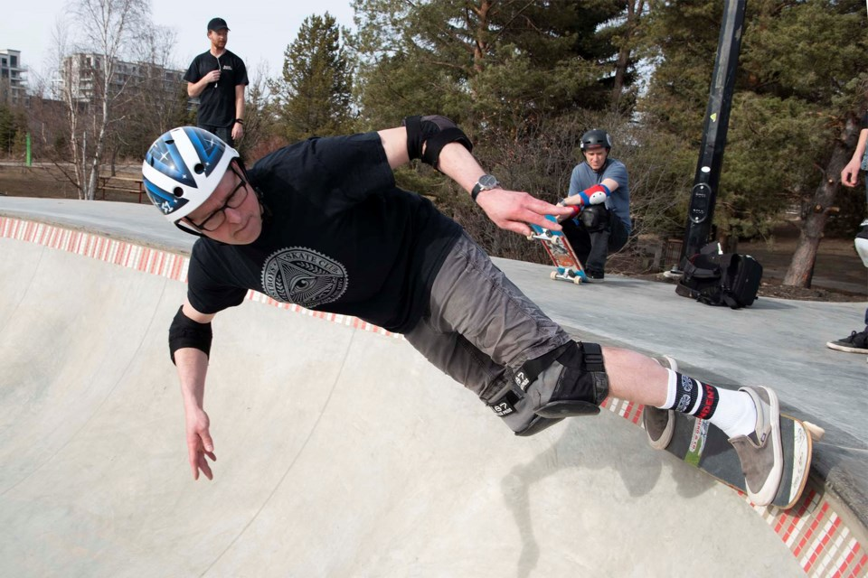 GRINDIN' — St. Albert resident Greg Groves performs a grind along the edge of the pool bowl at the renovated Woodlands Skatepark March 31, 2021. Groves said he was impressed by the rumbling noise the tiles on the lip of the bowl produced when rolled over. KEVIN MA/St. Albert Gazette