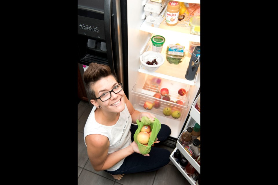 IT STARTS AT HOME —Cass Romyn of Gibbons has taken many steps to reduce plastic waste from her life, such as using reusable produce bags and water bottles and buying in bulk. KEVIN MA/St. Albert Gazette