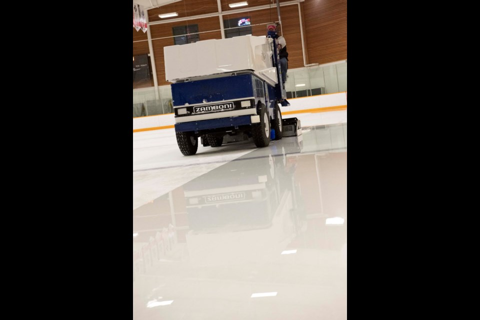 ACTUALLY ICE — City of St. Albert worker Nathaniel Curry drives a Zamboni stocked with water from a REALice water treatment system on Jan. 24, 2021. The system lets him resurface the rink without the use of hot water, reducing energy costs. KEVIN MA/St. Albert Gazette