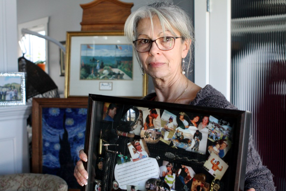 Annie Boychuk clutches a collage she made filled with memories of her late husband on Friday, March 6, 2020. Brent Boychuk died of a heart attack outside of a closed Sylvan Lake clinic in 2012. CLAIRE THEOBALD/Local Journalism Initiative