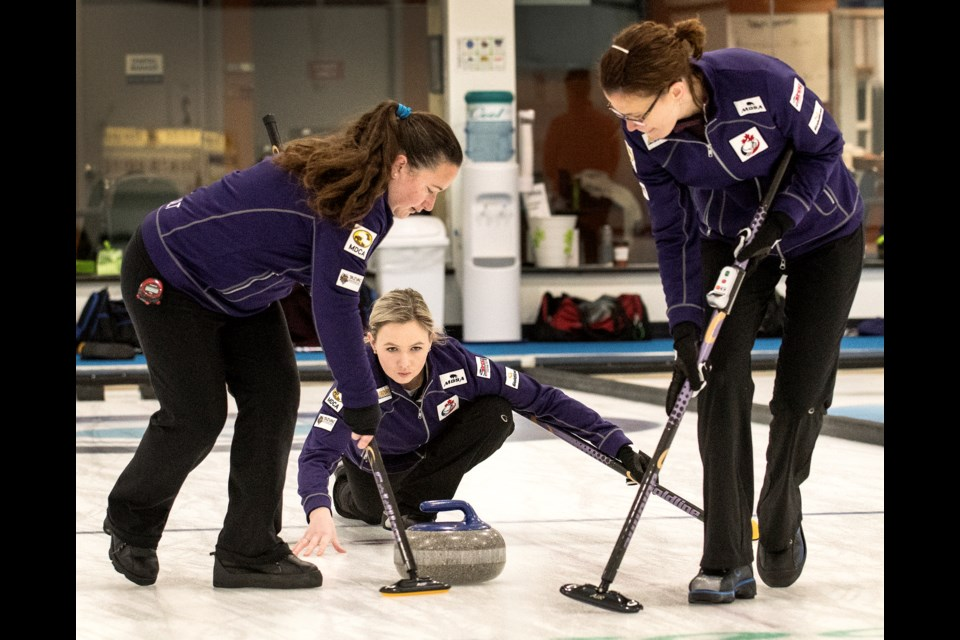 SPIELING – Nyla Kurylowich, right, of Sturgeon County and Susanne Beriault of Winnipeg sweep Holly Jamieson's skip rock during the St. Albert Ladies Bonspiel on Saturday. The Jamieson rink, with Sally Korol of Edmonton as third, alternate Sherry Clark of Winnipeg and coach Taina Smiley are gearing up to represent Canada at the Deaflympics, Dec. 9 to 21 at Madesimo, Italy. Jamieson, a Fort Saskatchewan curler with ties to the St. Albert Curling Club, Kurylowich and Korol curled together on the winning rink at the 2018 Canadian Deaf Games and all three competed at the 2017 World Deaf Curling Championships in Sochi as bronze medallists for Team Canada. DAN RIEDLHUBER/St. Albert Gazette