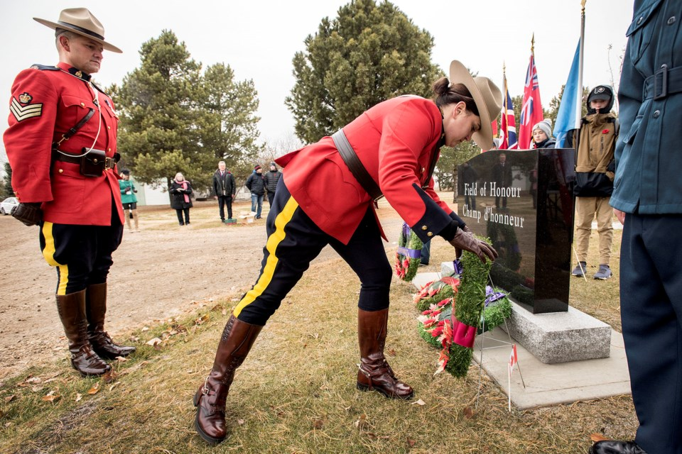 St. Albert RCMP Insp. Pam Robinson, right, and Sgt. Shayne Courtorielle place their wreath at the Field of Honour entrance during the No Stone Left Alone ceremony at St. Albert Municipal Cemetery Nov. 4. DAN RIEDLHUBER/St. Albert Gazette