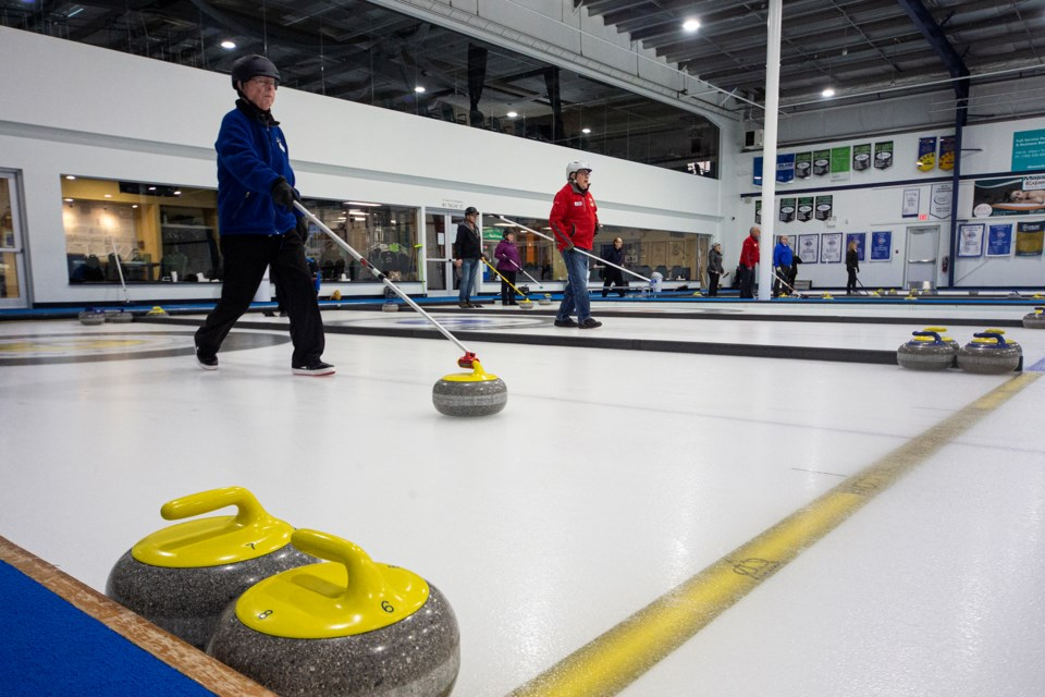 STICKING IT – Mel Yonker, who is 94 years young, delivers a rock in the St. Albert two-person stick league  Tuesday. Next weekend the St. Albert Curling Club hosts the Alberta Stick Curling Championships with 24 two-person teams competing for the provincial trophy sponsored by Milt and June McDougall of St. Albert. The winner will represent Alberta at the April 6 to 9 nationals in Regina. Randy and Ruby Olson of St. Albert are the defending Alberta champions. 
