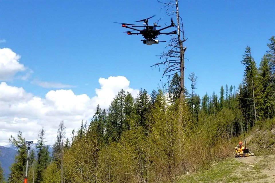 A drone hovers as part of a wildland firefighting mission.