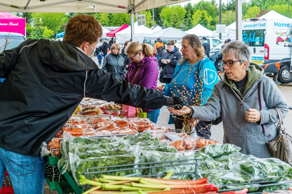 Despite the rain and cooler temperatures, shoppers were eager to attend the opening day of the annual St. Albert Farmers' Market on Saturday at its new location at Servus Credit Union Place. CHRIS COLBOURNE/St. Albert Gazette