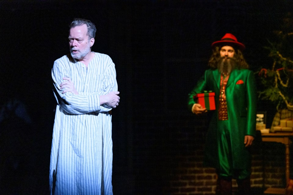 Scrooge (Ted Dykstra) is forced to face his actions as the Ghost of Christmas Present (John Ullyatt) forces him to face his actions in the newly revamped A Christmas Carol now playing at Citadel Theatre. IAN JACKSON/Photo