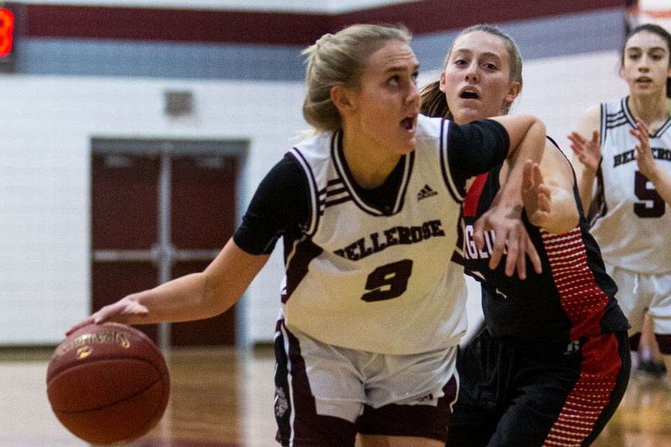 ROCKING THE BALL – Aneilia Ayotte of the Bellerose Bulldogs battles past Sadie Sullivan of the Sturgeon Spirits in the metro Edmonton division two league opener Monday at Bellerose. Ayotte scored a team-high 20 points in the 82-44 win for the 2019 division three champions. CHRIS COLBOURNE/St. Albert Gazette