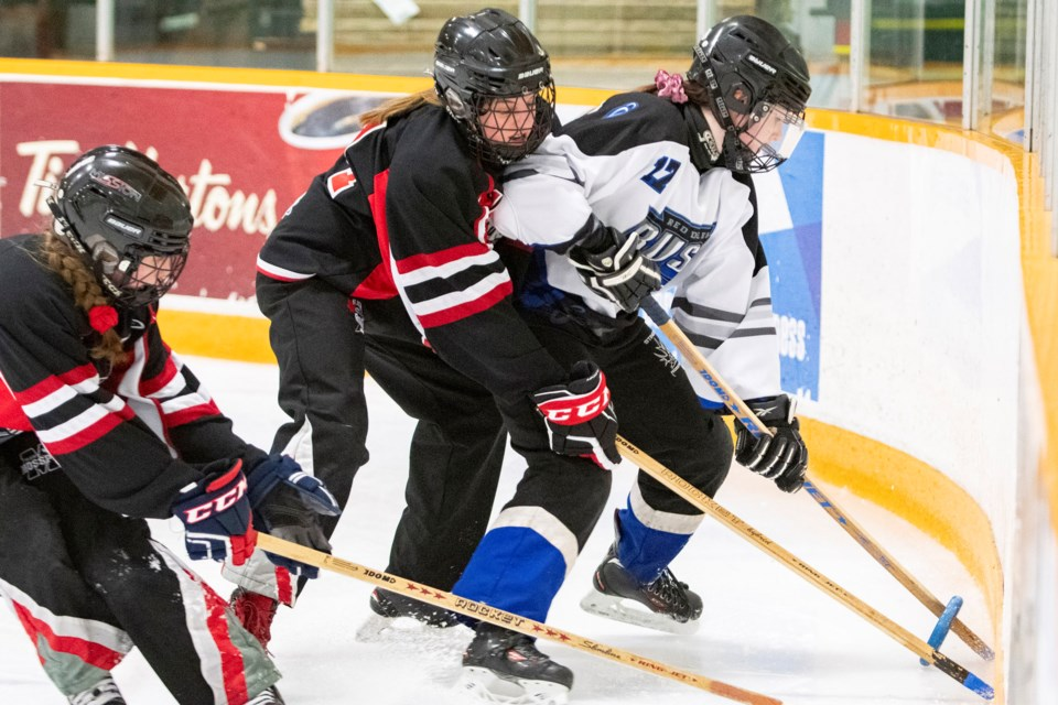 TRAPPED – Grace Debogorski of the Red Deer Rush is cornered by Tayte Arlinghaus, left, and Eve Starchuk of the St. Albert Mission in Saturday's U14AA Black Gold League game. The Mission won 4-0 at Mark Messier Arena. The Mission are 25-11-3-2 overall after Sunday's 10-3 decision against the Edmonton Elite at Go Auto Arena. The Ringette Alberta AA championships start Feb. 28 in Spruce Grove and four U14AA teams qualify for westerns in March at Prince George, B.C. 