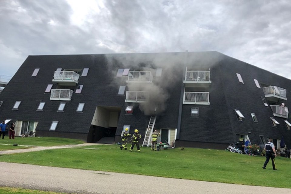 Firefighters on scene Friday afternoon at a blaze on Rivercrest Crescent. CAROLYN MARTINDALE/Photo