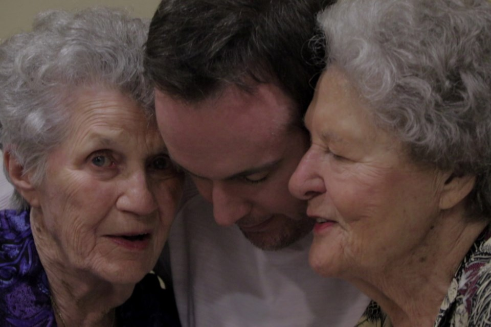 Chris Bolan shares a hug with Aunt Pat and his biological great-aunt Terry. Terry Donahue was a member of the All-American Girls Professional Baseball League, which was made famous in the movie A League of Their Own. NETFLIX/Photo