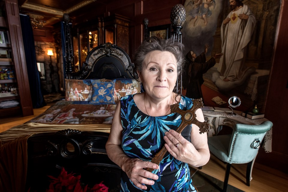 Barbara Ryan in The Royal Queen Isabella Suite of her newly opened Ryans Castle in Sturgeon County. Barbara is holding one of her many relics.  DAN RIEDLHUBER/St. Albert Gazette