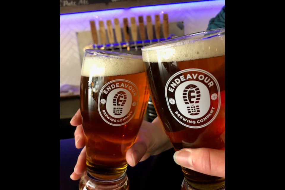 Locals share a craft beer from local brewery Endeavor Brewing Company in St. Albert.