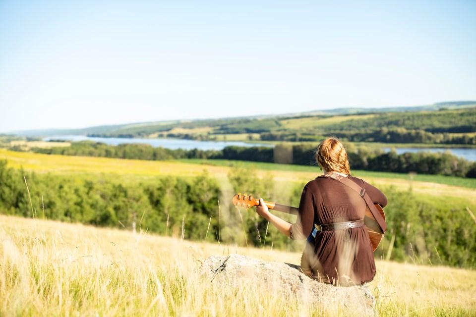Country singer Caroline Parke, nominated for five International Singer Songwriter Association Awards - sits on her Lloydminster ranch touching the banks of the Saskatchewan River.