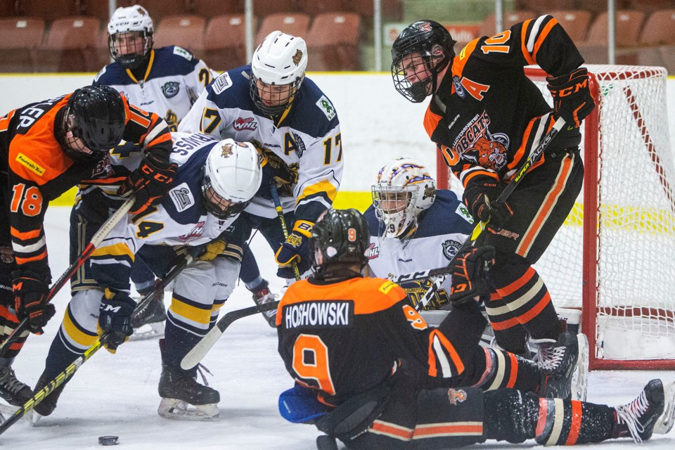 PUCK SCRUM – Adam Chin, netminder for the St. Albert Gregg Distributors Sabres, eyes up the puck along with teammates Kieran Strauss, left, and Johnny Ballos as Kale Tipler, far left, Brent Hoshowski and Ty Bryden of the Lloydminster Bobcats (9-4-6) in the vicinity during action on Raiders Day in St. Albert on Saturday. The Sabres won 2-1 with Carmelo Crandell and Jack Ketsa scored late in the third period at Go Auto Arena. Sunday the Sabres (17-4-1) lost 3-2 against the host Sherwood Park Flyers (9-8-4). The Sabres were 11-0-1 before the loss ended a seven-game winning streak. The next game is 10:45 a.m. Sunday versus the Calgary Royals (11-5-3) at Jarome Iginla Arena.  CHRIS COLBOURNE/St. Albert Gazette