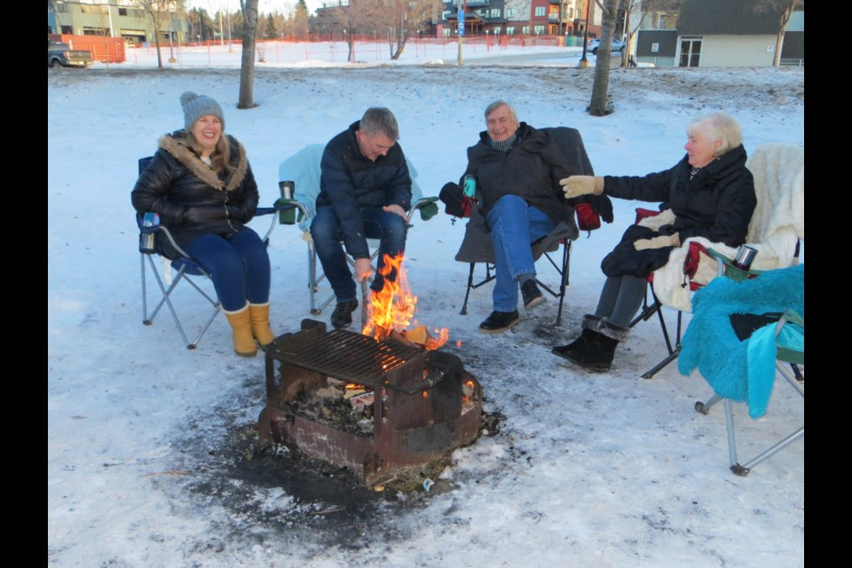 Two generations of Hargreaves enjoy a warm chuckle at Lions Park as a cinder explodes from the fire and lands on Steve's coat sleeve creating a burn hole. From left to right, Amanda, Steve, Peter and Ruth.