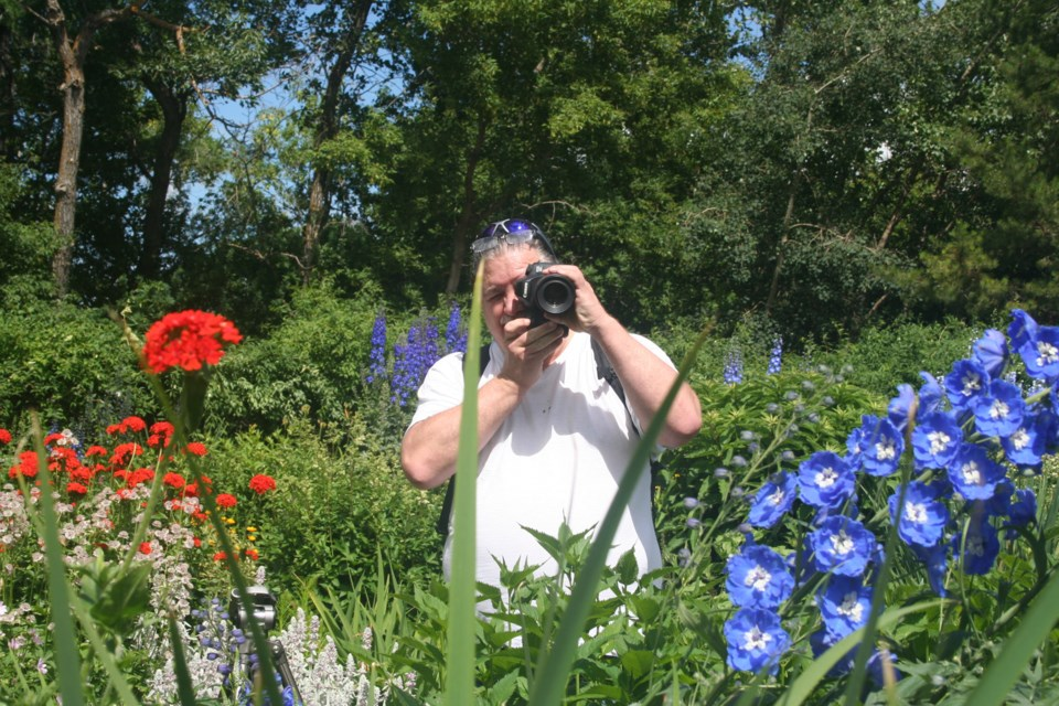 Amateur photographer Mervin Harper views St. Albert Botanic Park through his lens. The professional hairstylist stops by regularly to de-stress and shoot whatever is in bloom. ANNA BOROWIECKI/St. Albert Gazette