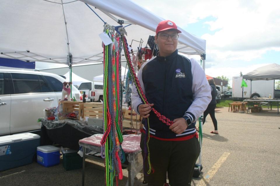 Douglas Bailey, a pet vendor at St. Albert Farmers' Market, displays his dog leashes woven from paracord. ANNA BOROWIECKI/St. Albert Gazette