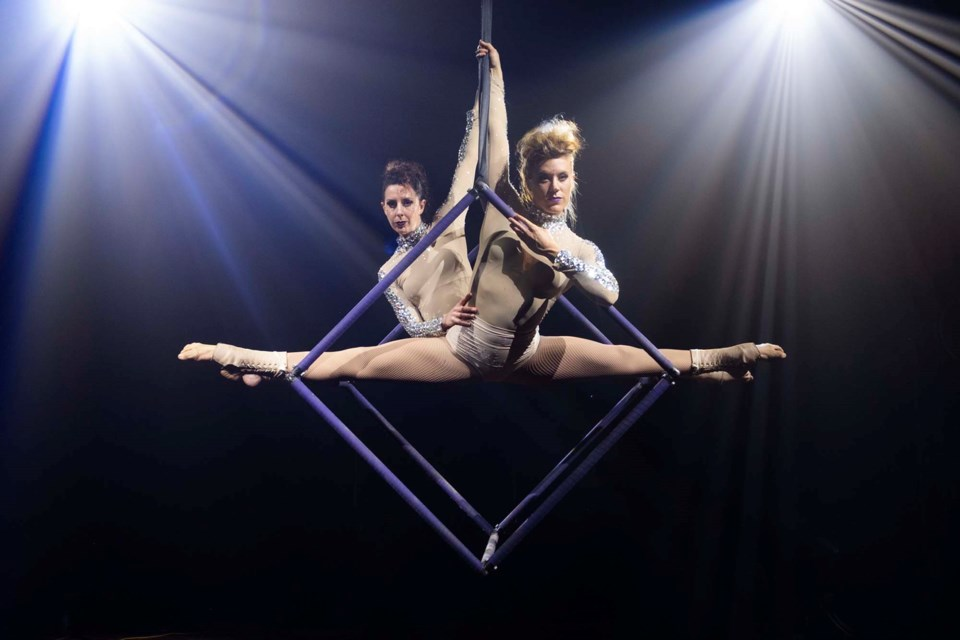 Kristi Wade, front, formerly of St. Albert, partners with Kirby Myers on the arial cube. The duo performs their routine at the Alberta Circus Arts Festival this weekend.