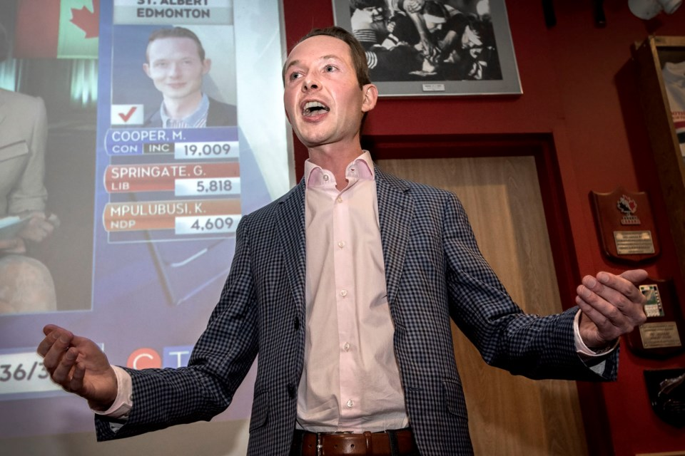 Conservative incumbent for St. Albert-Edmonton Michael Cooper  celebrates his federal election win Monday night while speaking to supporters at the St. Albert Rugby Club.  DAN RIEDLHUBER/St. Albert Gazette