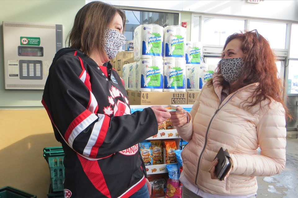 St. Albert Kinette Service and Public Relations Director Tracy Nadiger presented unsuspecting Save-On shopper Leanne Hartle with a $50 gift card on Saturday, Feb. 20 as part of National Kindness Day.