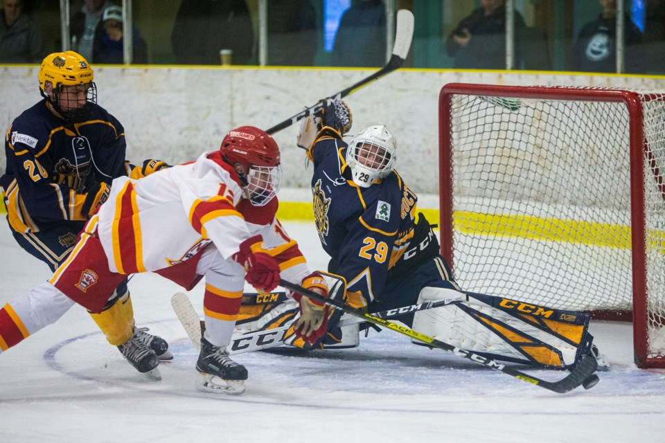 Andreai Proctor-Ramirez of the St. Albert Nektar Raiders stretches out to deny Matthew Mazzocchi a goal in Alberta Midget AAA Hockey League. ST. ALBERT TODAY PHOTO