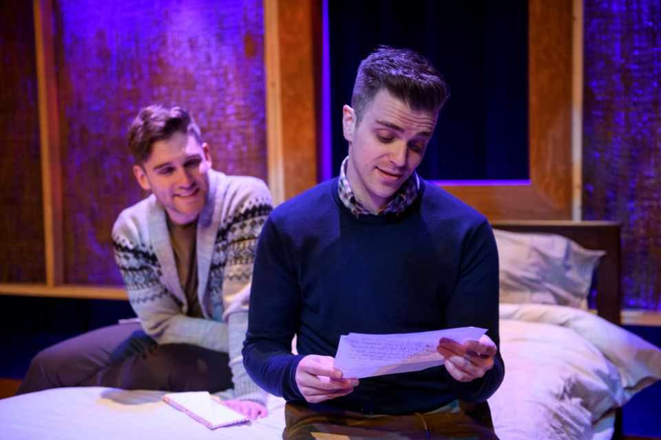 Drew (Chris Pereira) looks on while Brett (Mathew Hulshof) reads a touching letter from his mother during Theatre Network's production of Bed and Breakfast now running at The Roxy on Gateway. IAN JACKSON/EPIC PHOTOGRAPHY/Photo