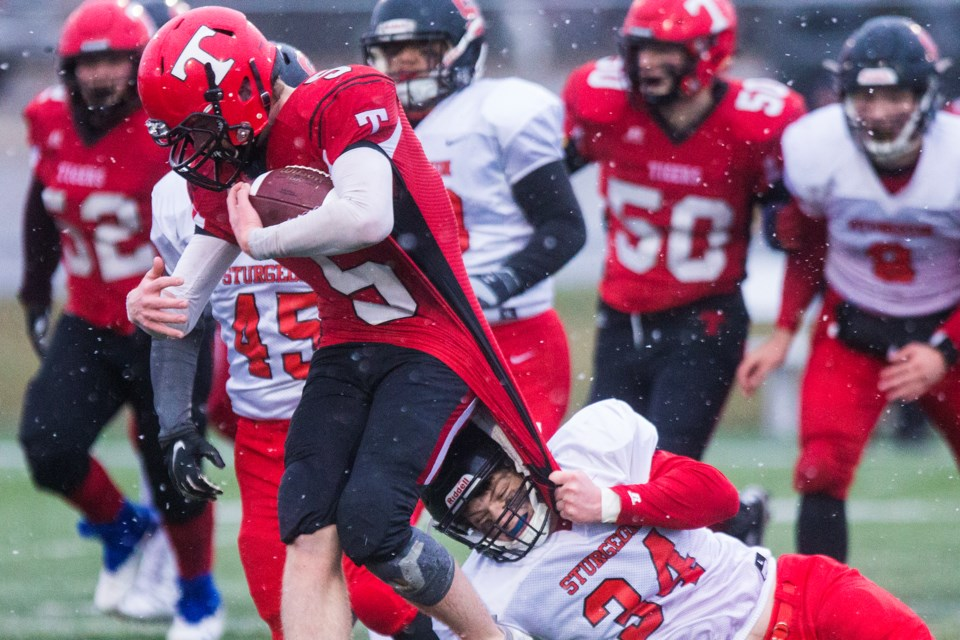 TIGER BY THE TAIL – Kalem Stuermer of the Sturgeon Spirits grabs a fist full of the ball carrier's jersey in Friday's division two Miles conference semifinal against the Leduc Tigers. The first loss after six consecutive wins for Sturgeon (6-2) was 29-14 at Larry Olexiuk Field. Leduc (5-1) will play the Paul Kane Blues (7-0) in Friday's final at 7:30 p.m. at Commonwealth Stadium and Sturgeon will gear up for the Tier III provincial north semifinal against the host Whitecourt Cats on Nov. 9. CHRIS COLBOURNE/St. Albert Gazette