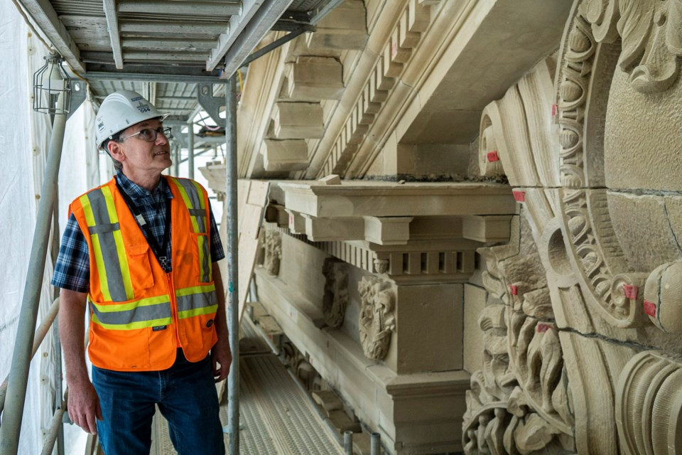 St. Albert's Rob Pacholok of Building Science Engineering inspects a large relief on the southwest side of the Alberta Legislature in mid May as workers perform a massive restoration project on the historic building. CHRIS COLBOURNE/St. Albert Gazette
