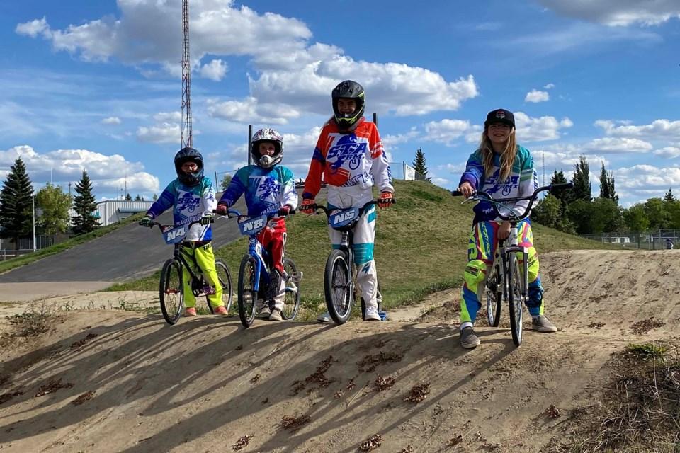 (L-R) Hailyn Walsh, Gretchen Hook, Ariana van Leeuwen, and Aaliyah van Leeuwen pose with their national plates at the St. Albert BMX track on August 29, 2021. PRESTON HODGKINSON/St. Albert Gazette