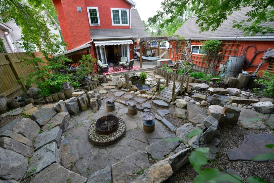 A view from the top of Mark Pesklewis's magnificent backyard, a space that he lovingly and patiently created with lots of found rocks and vintage antiques found on the cheap at thrift shops.