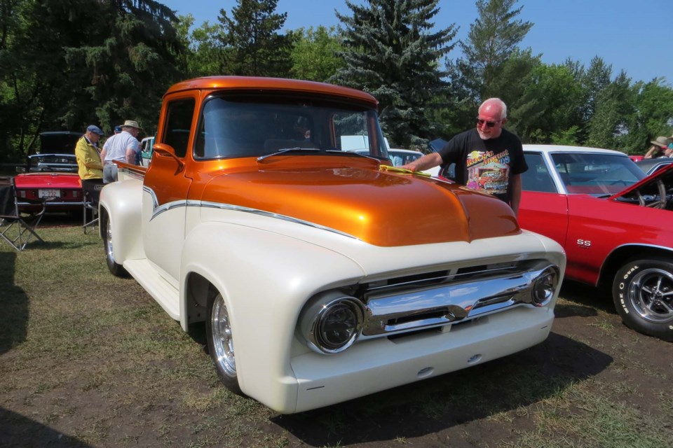Lorne Soloview demonstrates the true spirit of a Show and Shine as he polishes his grandfather's 1956 Ford truck. ANNA BOROWIECKI/St. Albert Gazette
