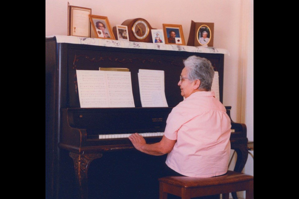 Beatrice Calliou at her piano in 1996. MUSEE HERITAGE MUSEUM/Supplied