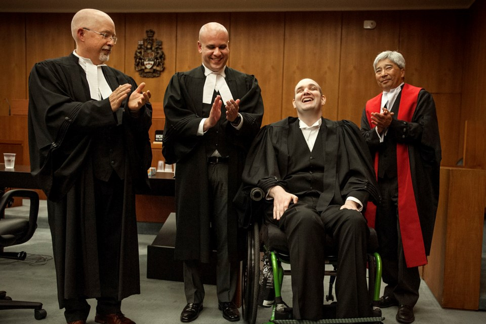 Wade Brown is gleeful after being called to the bar on Friday. He was joined in the ceremony by his presenting lawyer, Andrew Geisterfer, left, associate lawyer Adam Zibdawi and Court of Queens Bench Justice Douglas Mah. DAN RIEDLHUBER/St. Albert Gazette