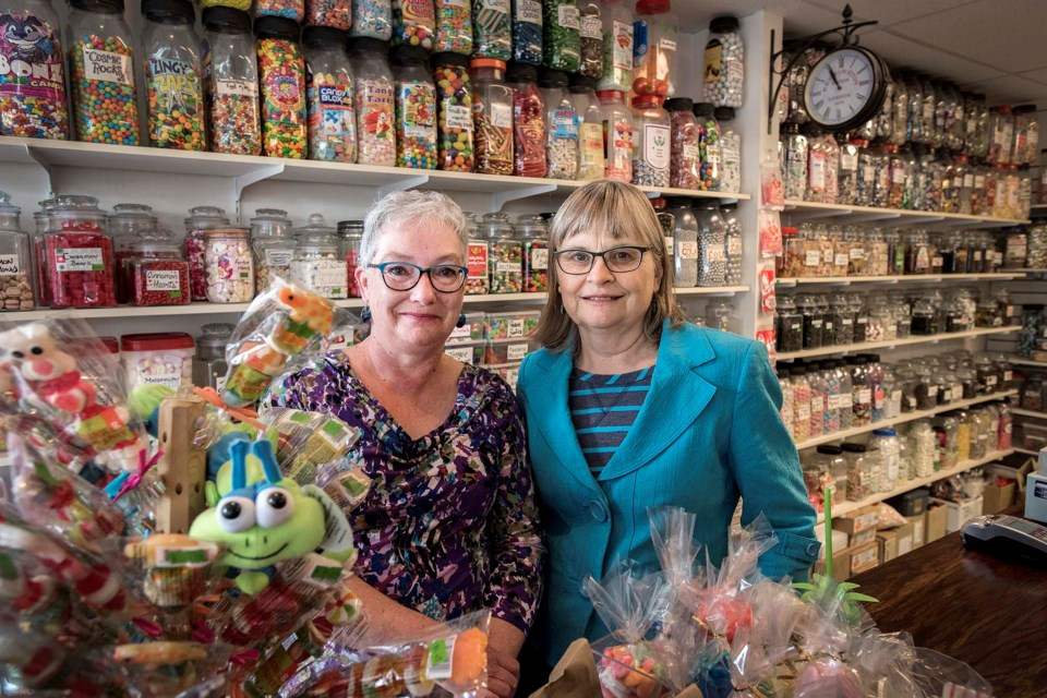 Candy Bouquet owners Gisele Sinclair, left, and Kathie Fisher, inside their store on Friday, July 19, have decided to retire and put their business up for sale. DAN RIEDLHUBER/St. Albert Gazette