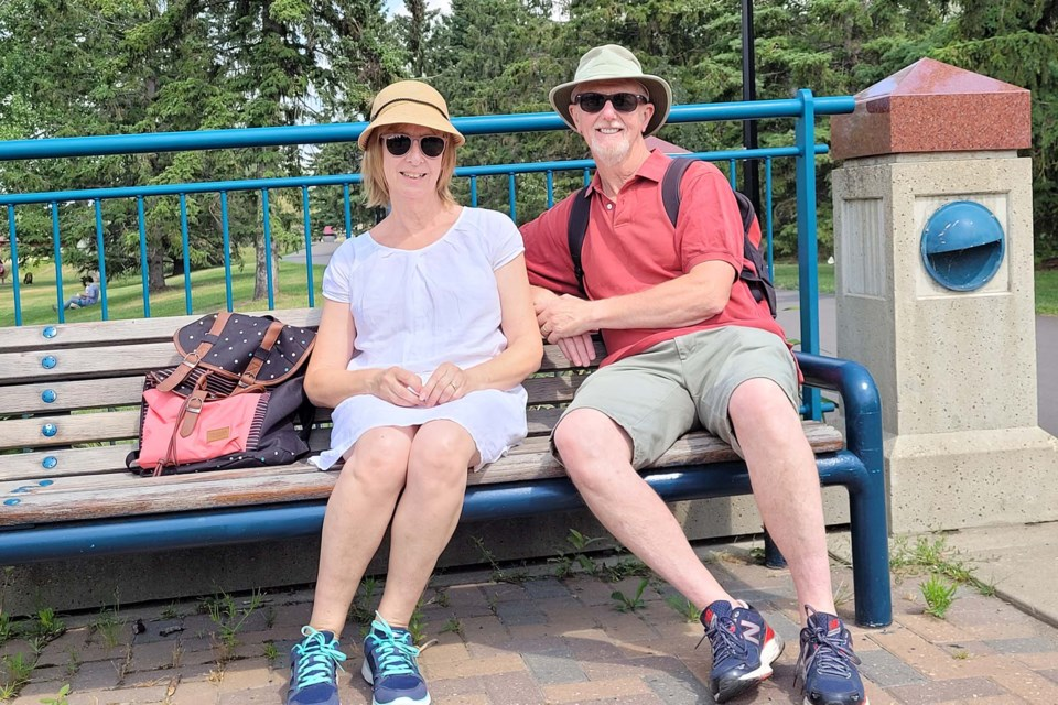 Chris and Julie Collison enjoy a break by the river outside Lions Park on Monday, July 26, 2021. Neither of them would mind if park-goers indulged in some light drinking in the park. ANDREW SMITH/St. Albert Gazette
