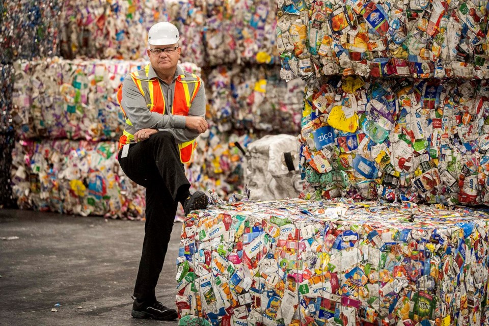 VALUABLE STUFF – Guy West, president of the Alberta Beverage Container Recycling Corporation, says recyclable items such as these tetra packs are valuable, but only if properly sorted. Alberta's producer-funded bottle depot system is designed to ensure pure streams of material that can easily be baled for sale.