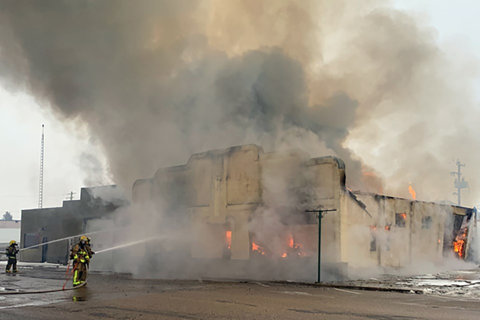 Westlock fire crews were called to a structure fire on 107 Street at 6:43 a.m. on Thursday, Nov. 14 and were on the scene throughout the day. The century-old building was being used as a storage warehouse for furniture and appliances, all of which were lost in the blaze. GEORGE BLAIS/WN photo