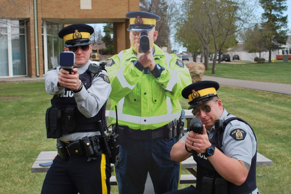Const. Scarecrow is flanked by Const. Grant Kirzinger and Const. Michael Hagel in Lloydminster. Const. Scarecrow has been missing since Saturday, Sept. 28. LLOYDMINSTER RCMP/Photo