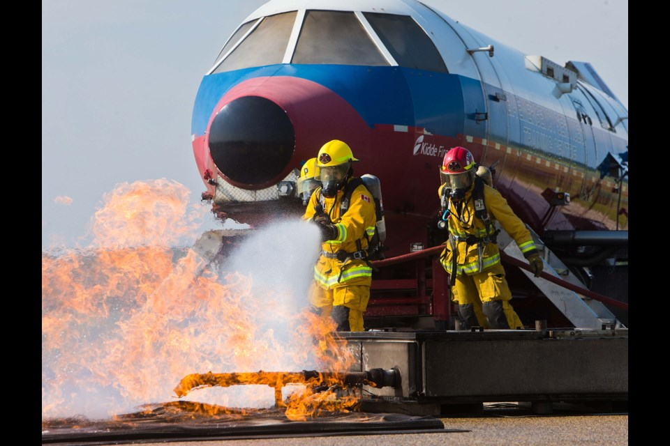 The Edmonton International Airport held a training exercise at Villeneuve Airport on Friday to train airport and county firefighters in how to respond to a crash. The simulation featured a plane fuselage complete with smoke and flames, a large burn pan on the ground to replicate a fuel spill, and volunteers who portrayed victims. CHRIS COLBOURNE/St. Albert Gazette