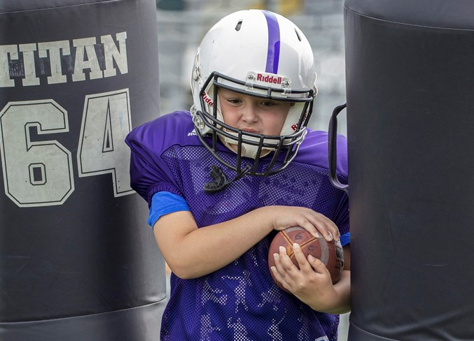 STRAIGHT AHEAD – Max Sponchia, 10, a returning player on the Vikings, punches through a set of tackle dummies during the first practice of the season Wednesday at Larry Olexiuk Field. The Vikings, Jaguars and Buccaneers are the St. Albert Minor Football Association atom teams in the Capital District Minor Football Association.