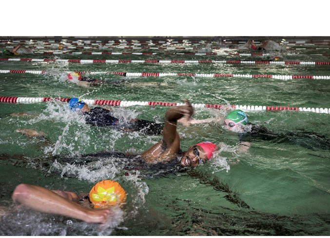 RACING AGAINST TIME – Ivan Kagoro churns out the strokes at the 30th annual St. Albert Triathlon on Sunday at Fountain Park Recreation Centre. Kagoro finished 11th overall in the sprint distance (750-metre swim, 20-kilometre bike and five-km run) at 1:13:13.8 for top spot in the male 30 to 34 age division. The winner was Ryan Kohlenberg of St. Albert at 1:07:04.3. Overall, 136 competitors completed the sprint event, 27 in the try-a-tri (250-m swim, 10-km bike, 2.5-km run) and four sprint teams also competed. The triathlon was hosted by the St. Albert Road Runners and Triathlon Club. DAN RIEDLHUBER/St. Albert Gazette