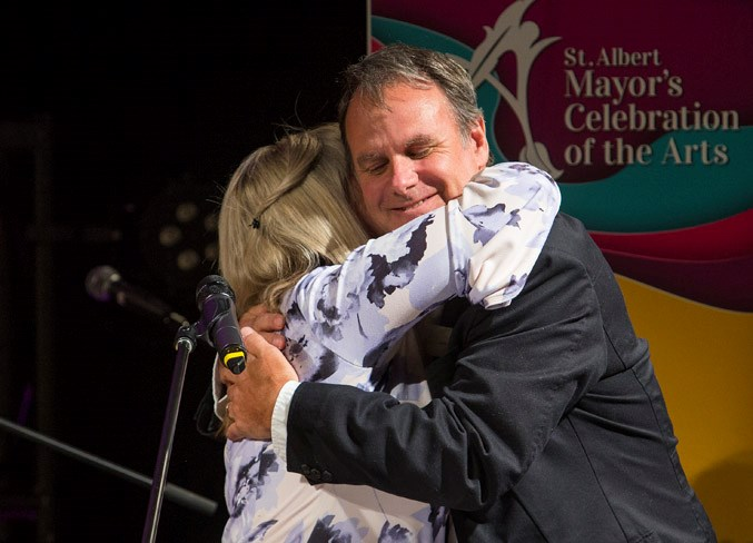 St. Albert Mayor Cathy Heron hugs local artist Lewis Lavoie, who received the Lifetime Achievement Award at the Mayor's Celebration of the Arts Awards ceremony at the Enjoy Centre on Thursday evening. CHRIS COLBOURNE/St. Albert Gazette