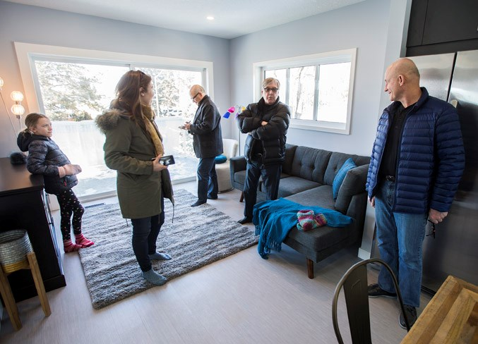 The Tuttle family held an open house and tour of their newly built garage suite in St. Albert.