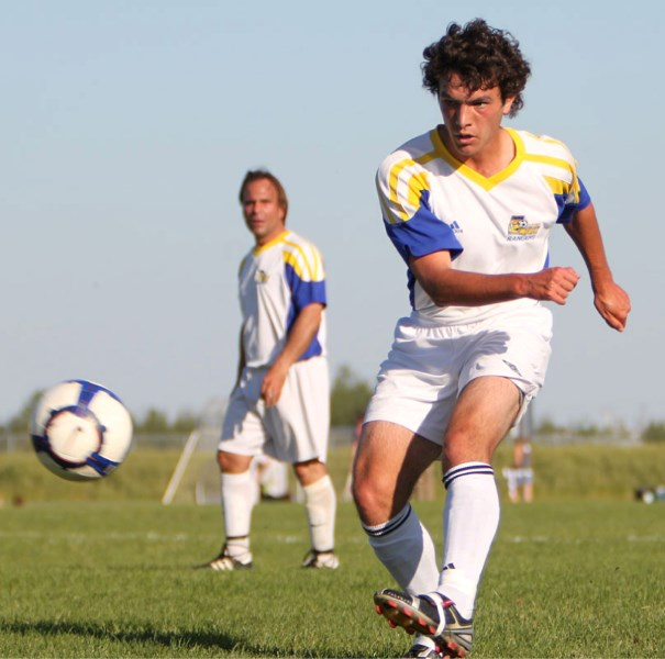 Sal Camminitore of the St. Albert Impact Rangers kicks the ball ahead during Thursday's game against Africana FC. The 4-4 draw means the Rangers only have two games