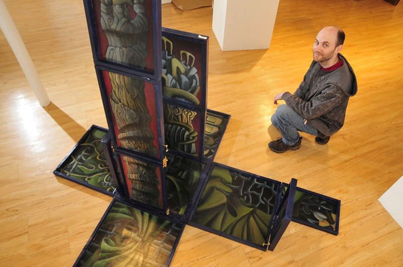 Artist Byron McBride with his work The Garden Polyptych