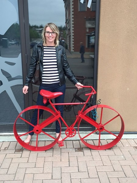 Joanne Guthrie's welded red bike was put on display at Cranky's Bike Shop during the Farmers' Market on Saturday.