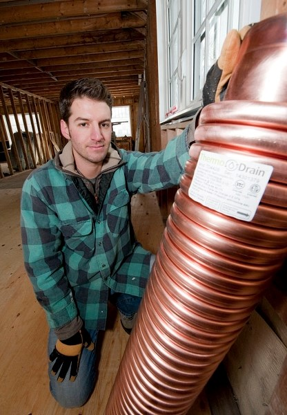 RECOVERING HEAT – Former St. Albert resident Stuart Fix shows off the drain heat recovery device he plans to install as part of his renovation of his new home in Edmonton in