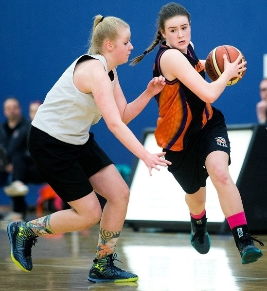 DRIVE TIME – Aine Murphy of the St. Albert SLAM midget A team pushes past a defender in Sunday's 51-30 win over SBA Caldwell in the Youth Provincial Championships