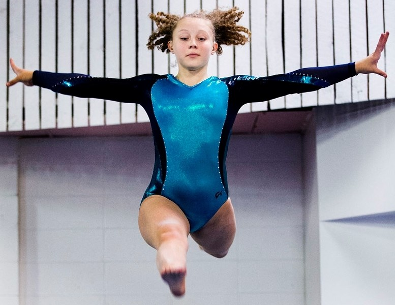 JUMPING FOR JOY – Emily Pilat of the Dynamyx Gymnastics Club will compete at westerns this weekend in Richmond