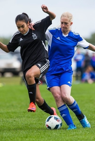AGGRESSION – Suzanne Schulz of Mavericks 09 jostles for the ball in Monday's 2-1 loss to the KC Trojans in the Tier III provincial final at the ESA Complex. Schulz